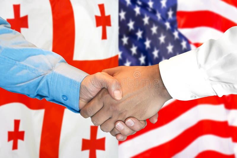 关于格鲁吉亚和美利坚合众国国旗背景的握手 免版税库存图片