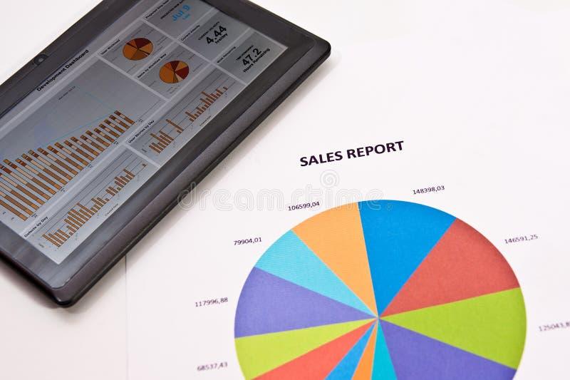 关于片剂的销售报告 免版税库存照片