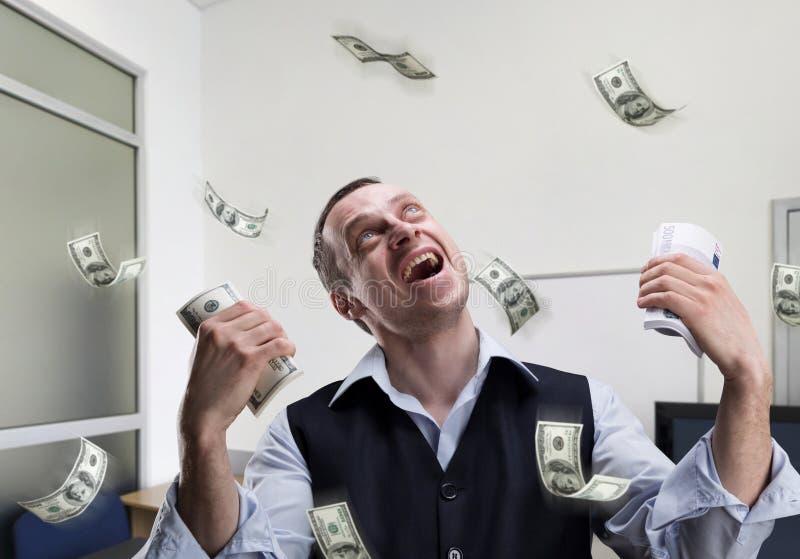 关于金钱的愉快的商人梦想 库存照片