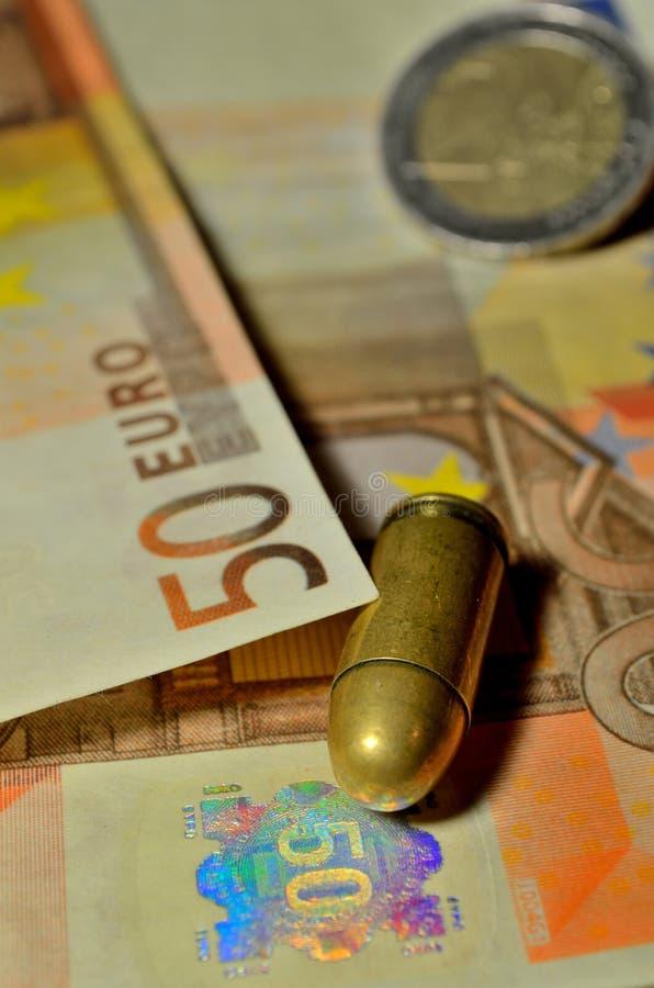 子弹和金钱 库存图片