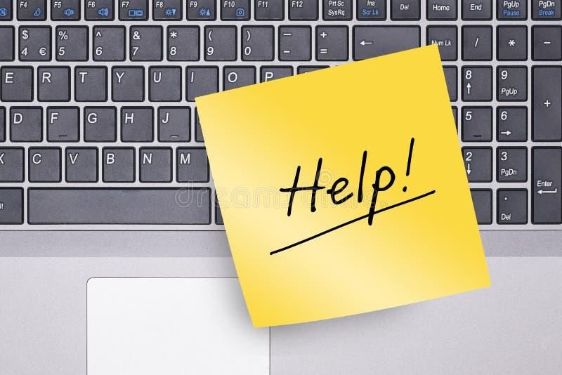 关于键盘的帮助笔记 免版税图库摄影
