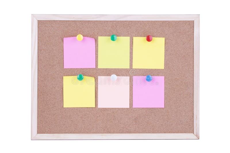 关于黄柏板的五颜六色的稠粘的纸笔记,白色背景 库存照片