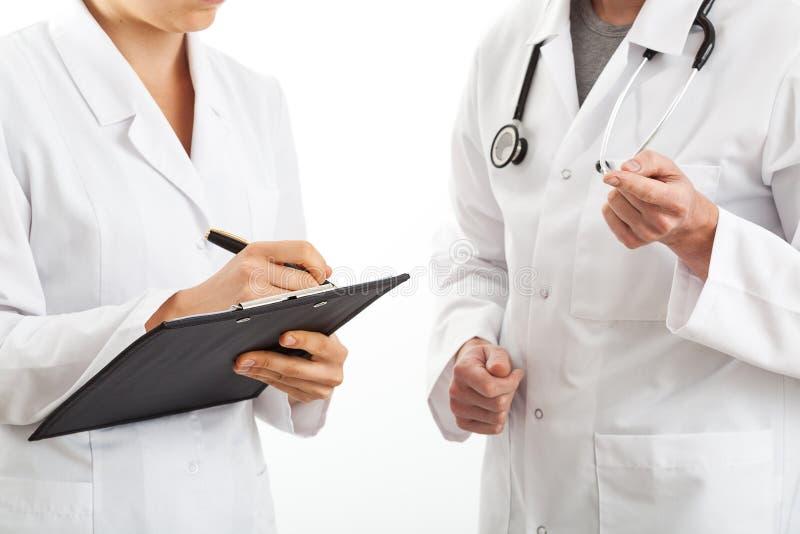 关于医疗诊断的交谈 免版税库存图片