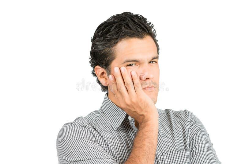 关心的西班牙男性杯的面孔手在 库存图片