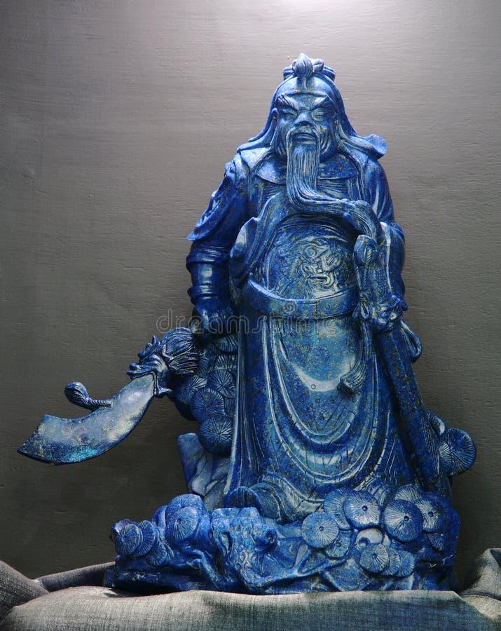 关羽,上帝蓝色玉雕塑诚实在中国 免版税库存图片