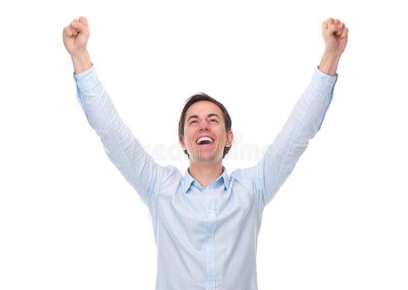 关闭一个年轻人的画象有在庆祝举的胳膊的 免版税图库摄影