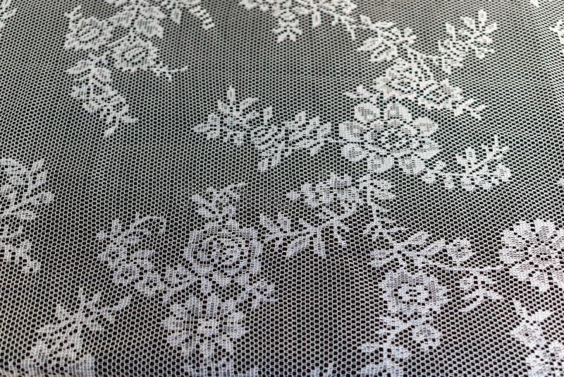 关闭一美好的白色钩针编织tablec的纹理/样式 库存照片