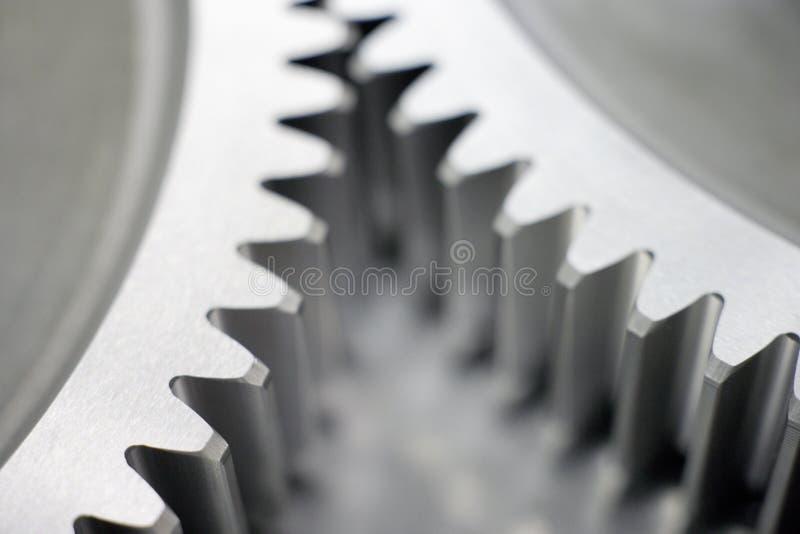 关闭一部分的两个精确度嵌齿轮轮子 图库摄影