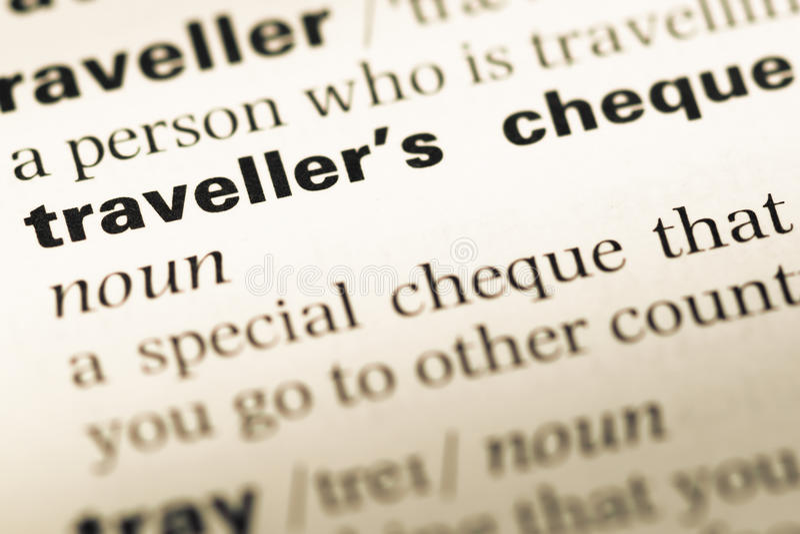 关闭与词旅行支票的老英国字典页 图库摄影
