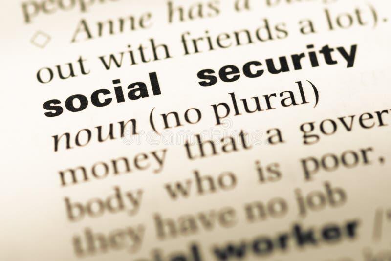 关闭与词社会保险的老英国字典页 免版税库存图片