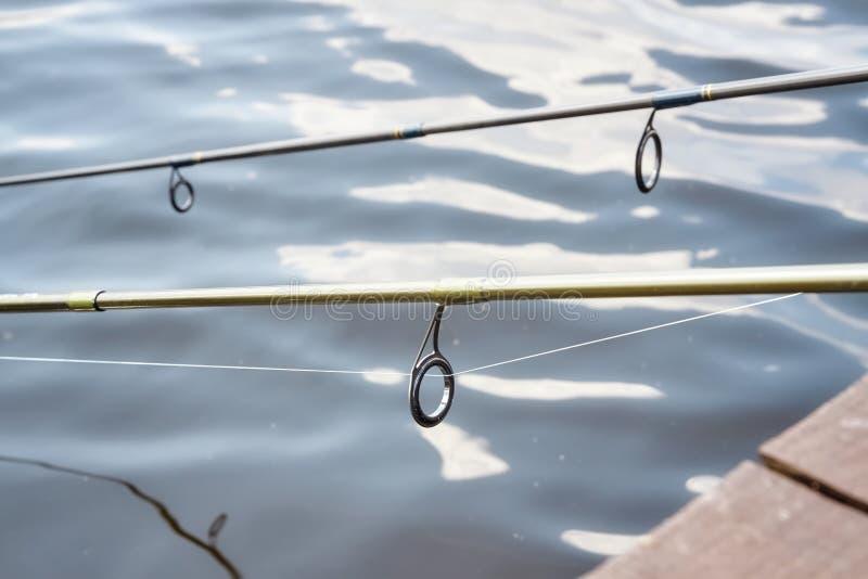 关闭两个钓鱼竿指南的图片 免版税库存照片