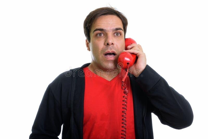 关闭体贴的年轻波斯人谈话在老telephon 免版税图库摄影