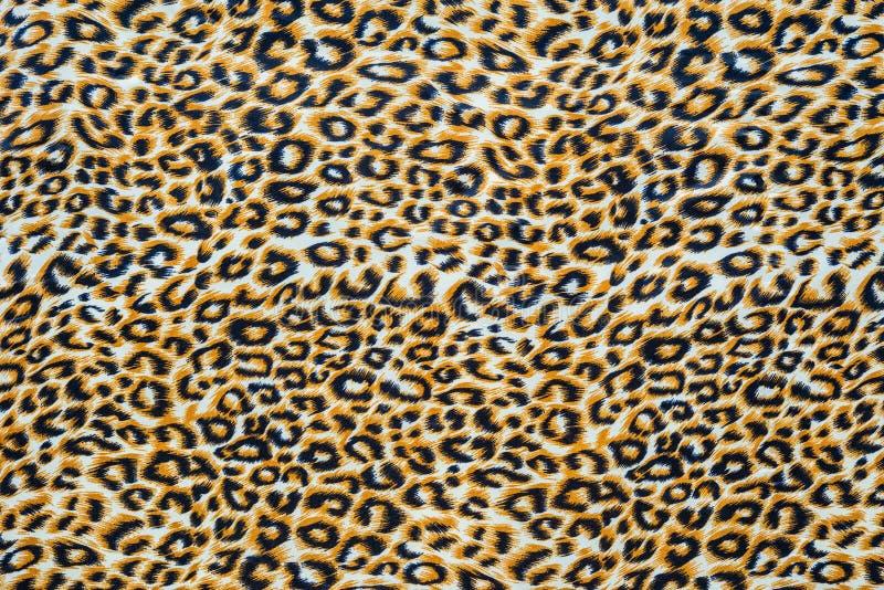 关闭印刷品织品纹理镶边了豹子 库存图片
