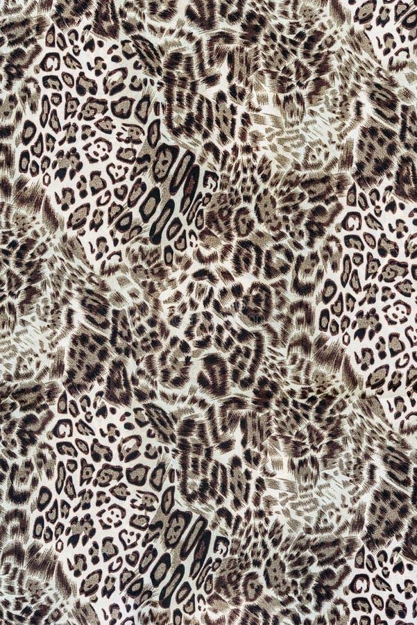 关闭印刷品织品纹理镶边豹子 库存图片
