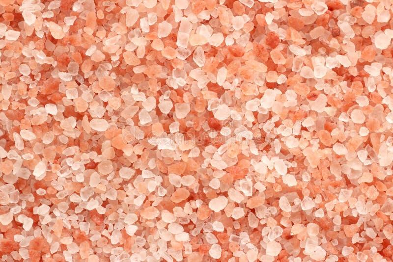关闭喜马拉雅桃红色盐纹理背景顶视图与高分辨率的 免版税库存照片