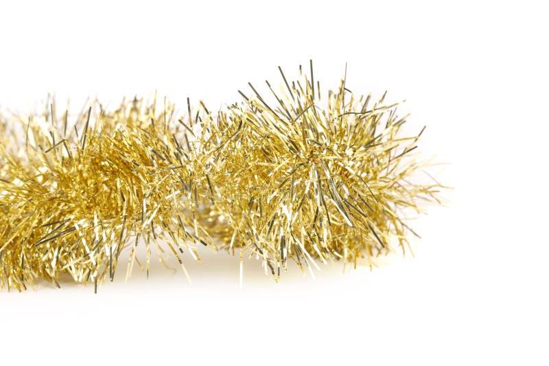 关闭圣诞节黄色闪亮金属片。 库存照片