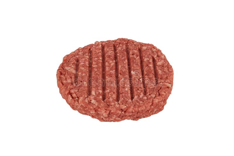 关闭在一个未加工的绞细牛肉汉堡牛排小馅饼 免版税图库摄影
