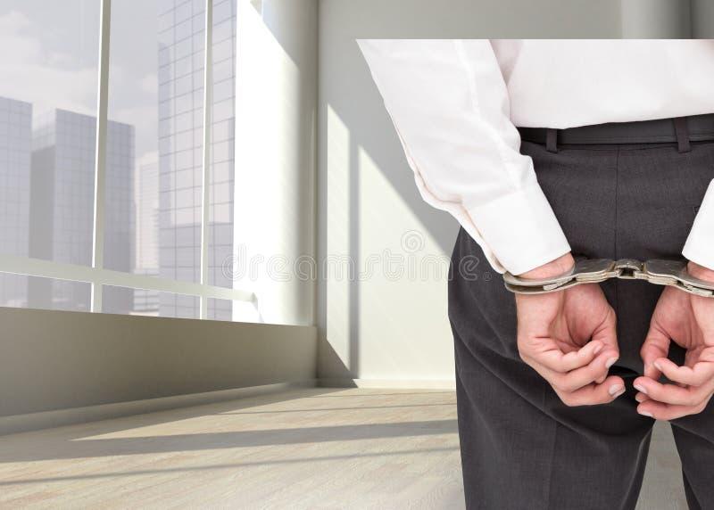 关闭在优等的商人佩带的手铐 免版税库存照片