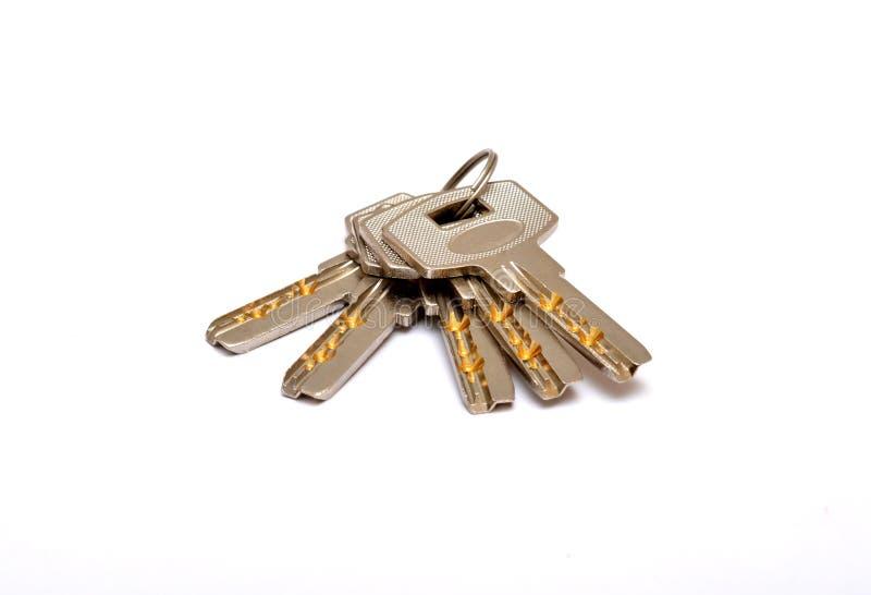 关闭在白色家庭概念隔绝的钥匙 图库摄影