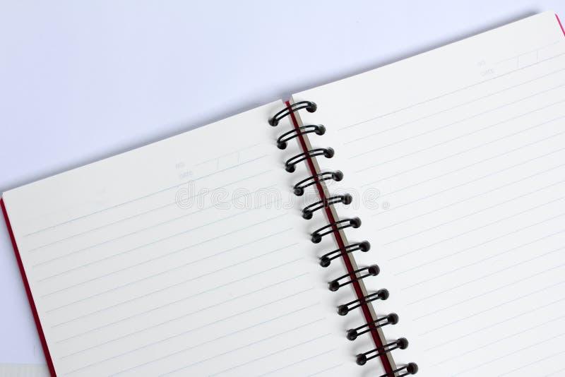 关闭在白色桌上的书 免版税库存图片