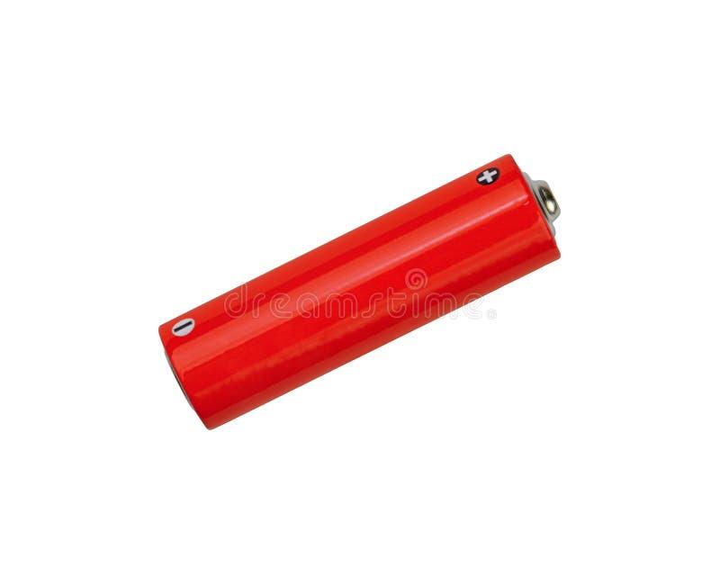 关闭在白色的一个红色碱性AA电池 图库摄影