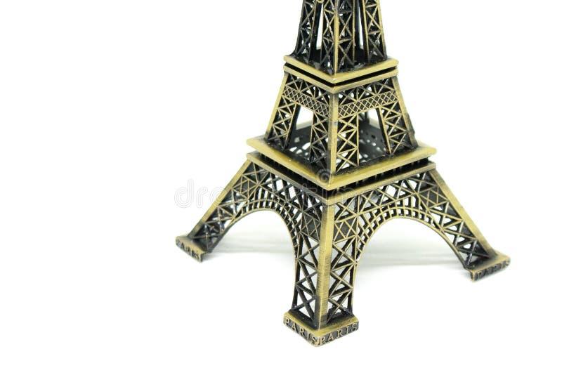关闭在白色背景隔绝的埃佛尔铁塔模型的建筑学零件 免版税库存图片