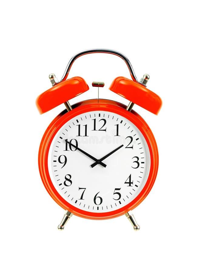 关闭在白色(闹钟)隔绝的一个红色响铃时钟 免版税库存图片