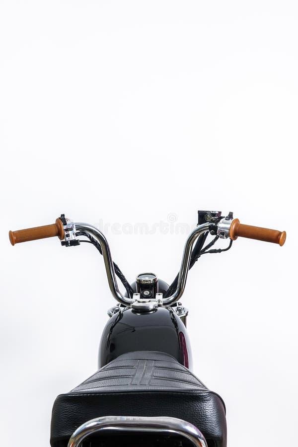 关闭在葡萄酒摩托车的把手和汽油箱 Custo 免版税图库摄影