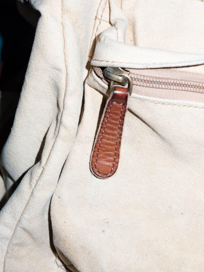 关闭在袋子的一个棕色皮革邮编 免版税库存图片