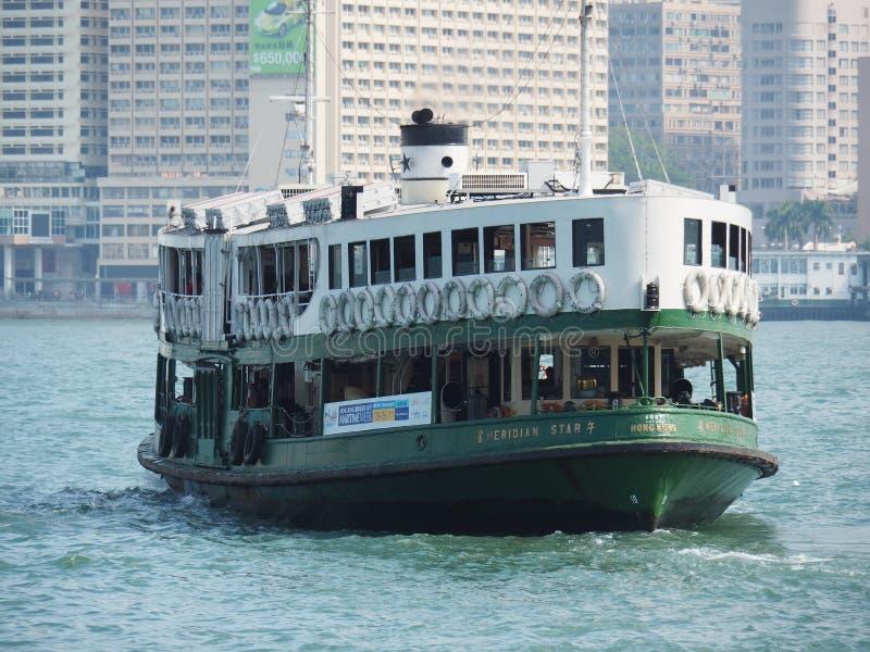 关闭天星小轮的前面在香港 在图片的船同行陪 免版税库存图片