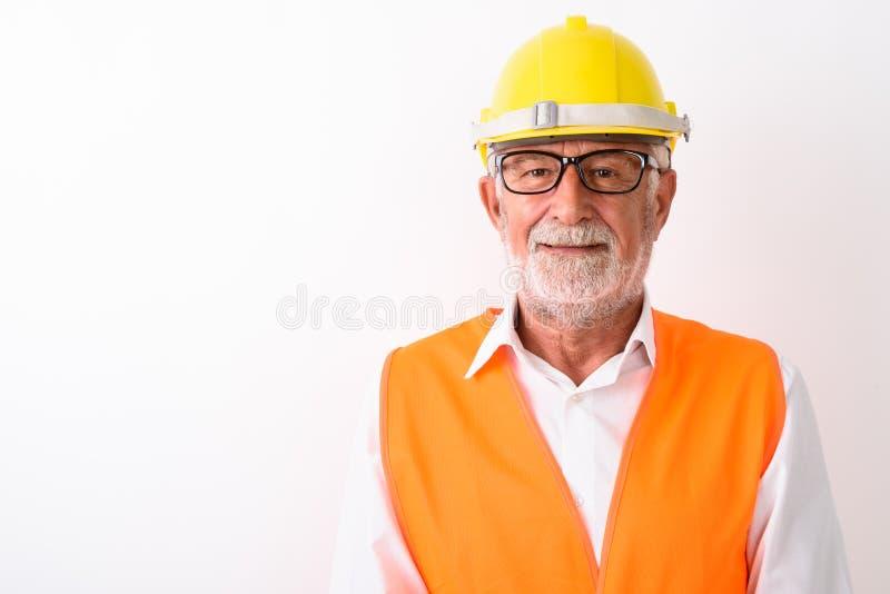 关闭愉快资深有胡子人建筑工人微笑 库存图片