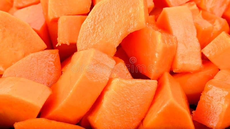 关闭成熟番木瓜果子背景纹理 库存照片