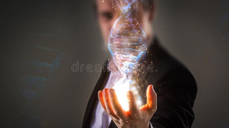 关闭拿着与能量sp的商人发光的脱氧核糖核酸螺旋 免版税图库摄影