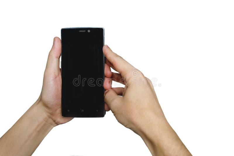 关闭拿着智能手机的人的手 免版税库存图片