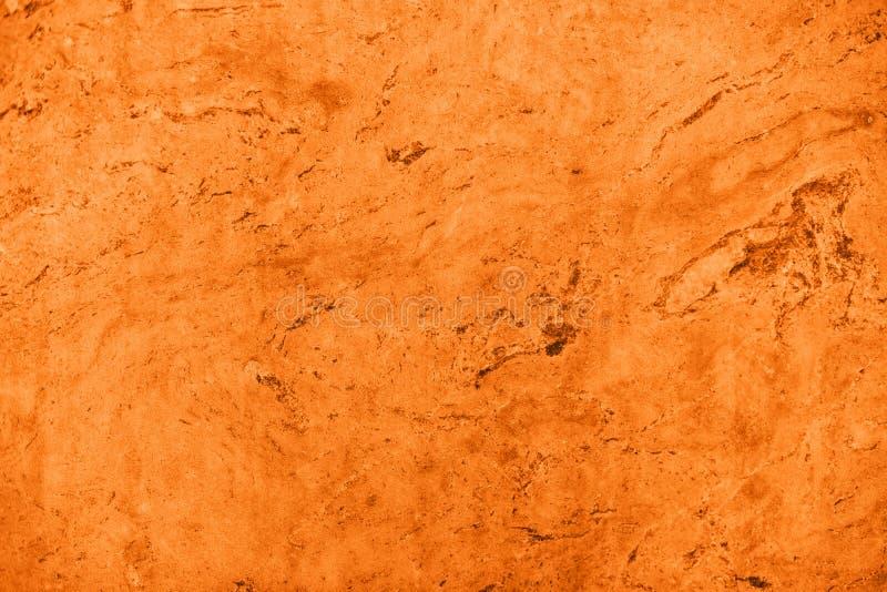关闭摘要姜黄橙色石纹理 免版税库存照片