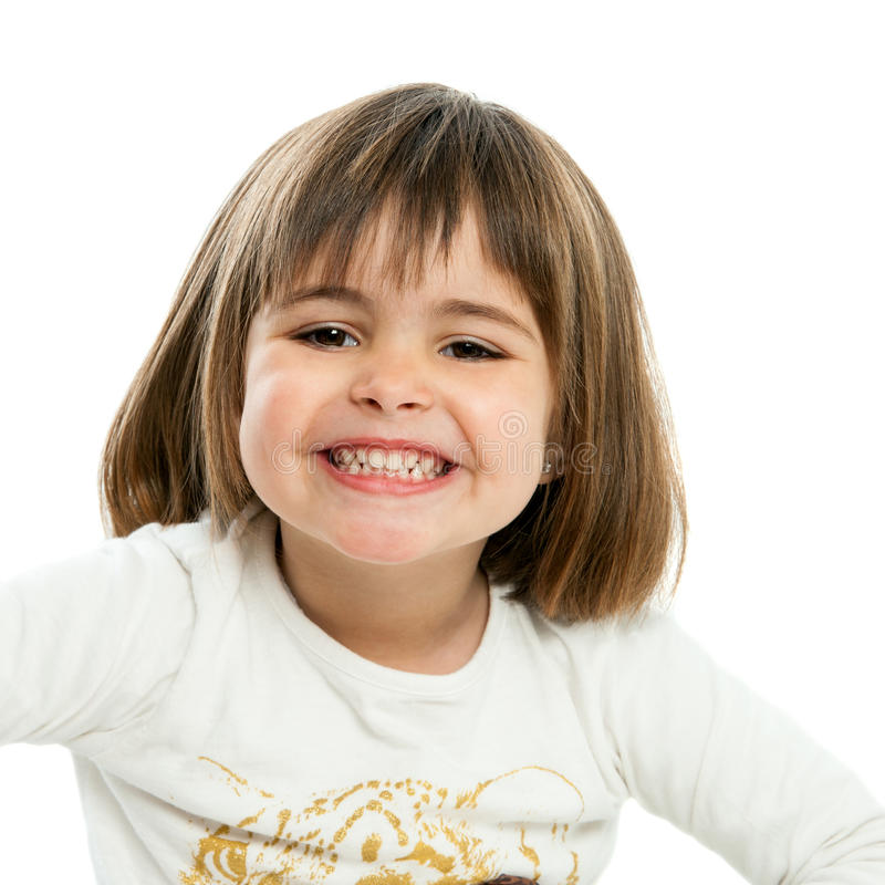 显示牙的甜女孩。 免版税库存照片