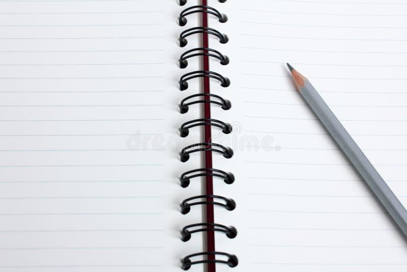 关闭有书的铅笔 库存照片