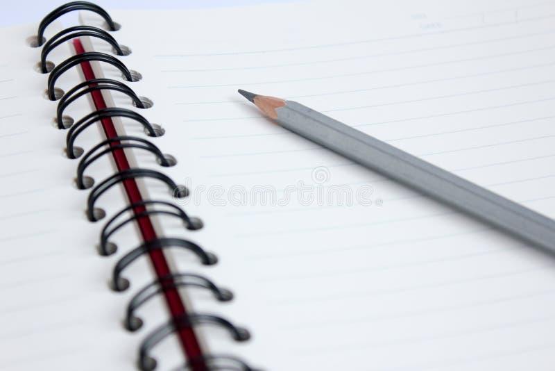 关闭有书的铅笔 库存图片
