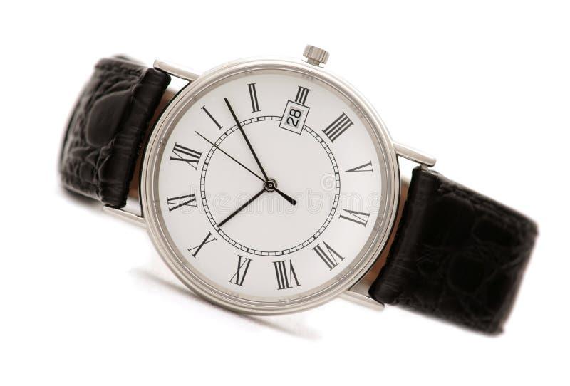 关闭查出的人s手表 免版税库存照片