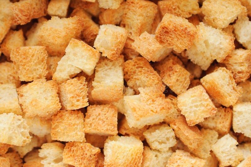 关闭油煎方型小面包片  免版税库存照片