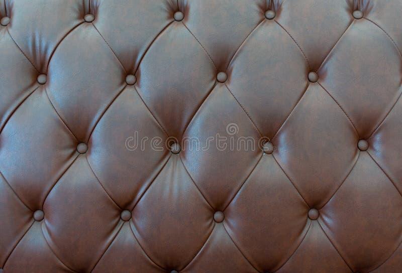 关闭用皮革包盖沙发纹理  库存照片