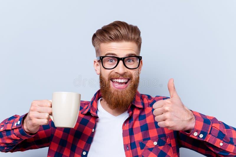 关闭疯狂的愉快的微笑的人照片眼镜举行的 免版税图库摄影