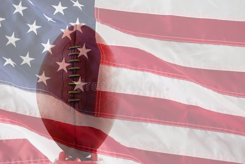 关闭的综合图象在发球区域的棕色美式足球 免版税图库摄影