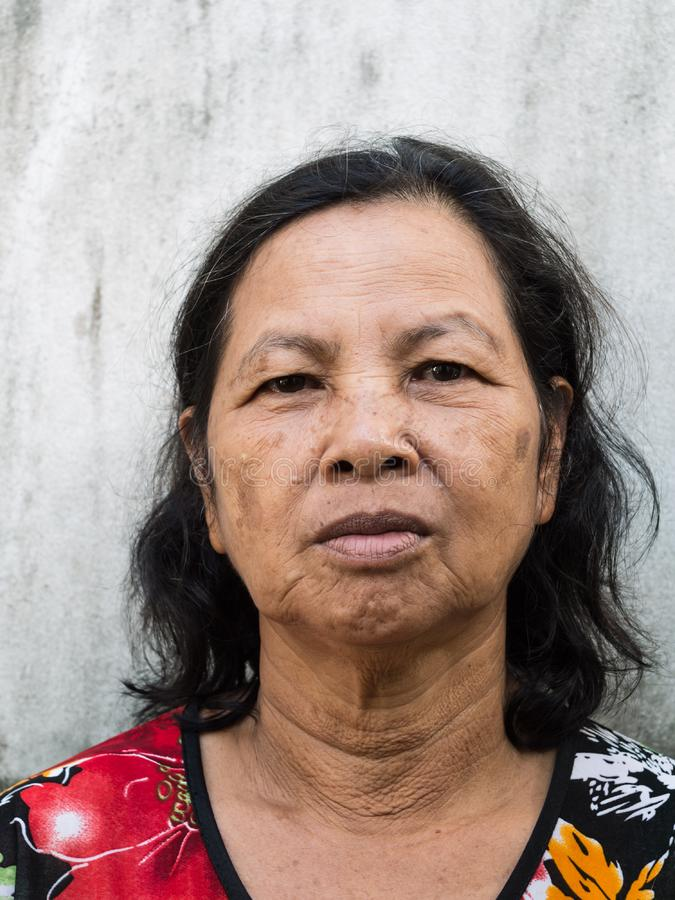 关闭老泰国妇女画象 免版税库存照片