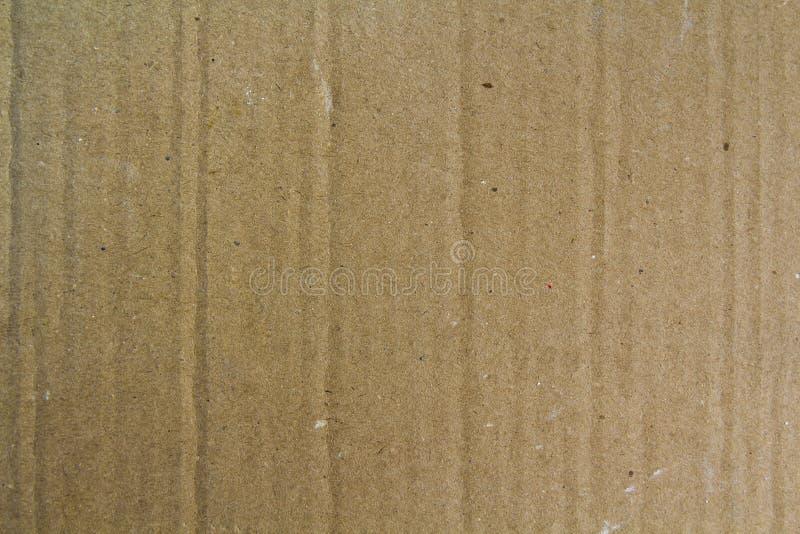 关闭老粒状装饰浅褐色的纸盒纸板纸纹理或背景葡萄酒粗砺的板料  免版税图库摄影