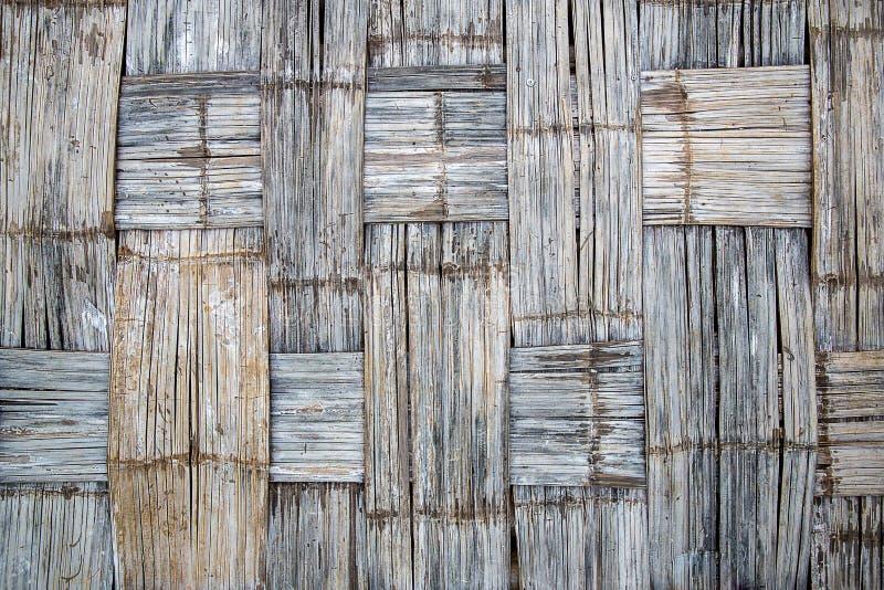 关闭背景的墙壁竹子被编织的样式 10个背景竹eps例证向量 竹样式老篱芭,肮脏的竹表面背景 免版税图库摄影