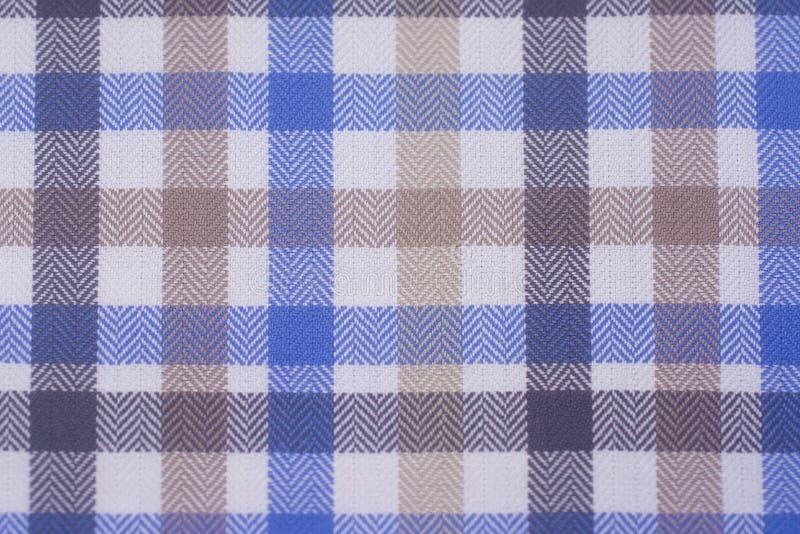 关闭蓝色被编织的棉纺织品背景 库存图片