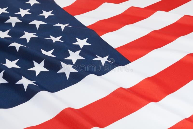 关闭被翻动的国旗射击-美国 免版税库存图片