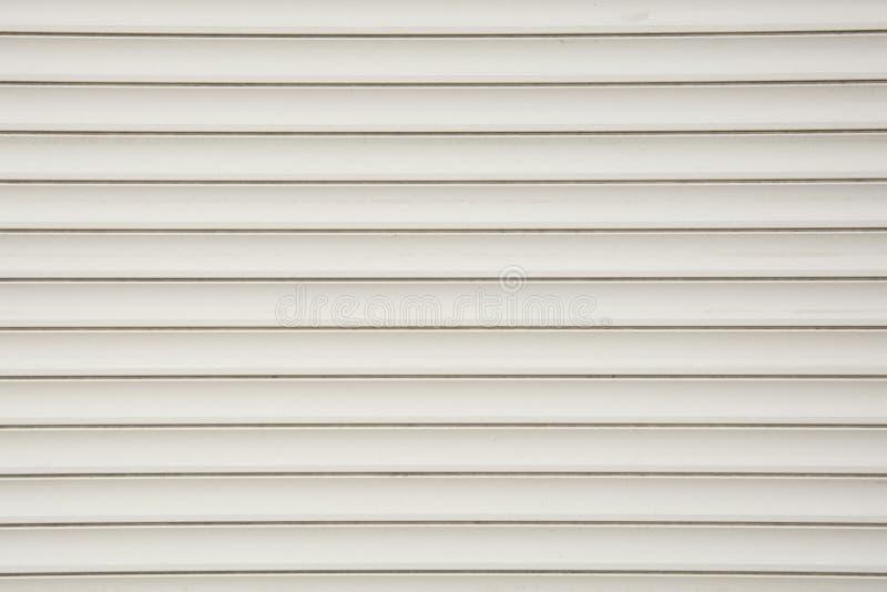 关闭路辗快门门,塑料白色纹理背景 免版税图库摄影