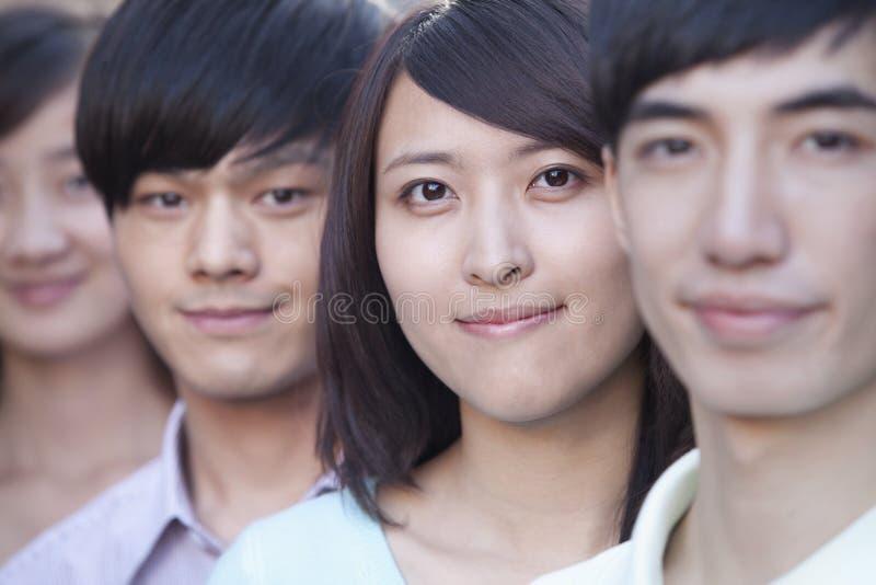 关闭连续站立在北京的四青年人 库存照片